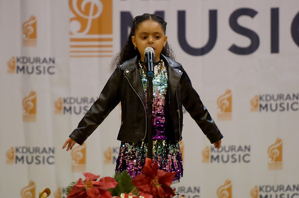 TIM JEAN/Staff photo <br /> <br /> Avani Hernandez, 6, sings a holiday song on stage during the KDuran Music Christmas concert at Esperanza Academy in Lawrence.      12/21/19