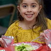 TIM JEAN/Staff photo <br /> <br /> Amy Garcia, 8, enjoys a salad as well as the buffet dinner during Haverhill's Boys & Girls Club annual Christmas party.     12/13/19