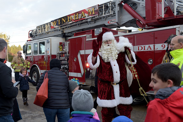 TIM JEAN/Staff photo <br /> <br /> Santa  waves to the children as he arrives by fire truck outside of the Windham Town Hall during the Windham Tree lighting celebration. 12/7/19