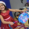 TIM JEAN/Staff photo <br /> <br /> Arianna Estrada sits on the new bicycle she won in a raffle during Haverhill's Boys & Girls Club annual Christmas party.     12/13/19