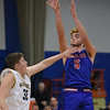 TIM JEAN/Staff photo <br /> <br /> Londonderry's Cole Keegan shoots over Andover's Logan Satlow during the Commonwealth Motors Christmas Classic basketball tournament. Londonderry defeated Andover 55-53.     12/27/19