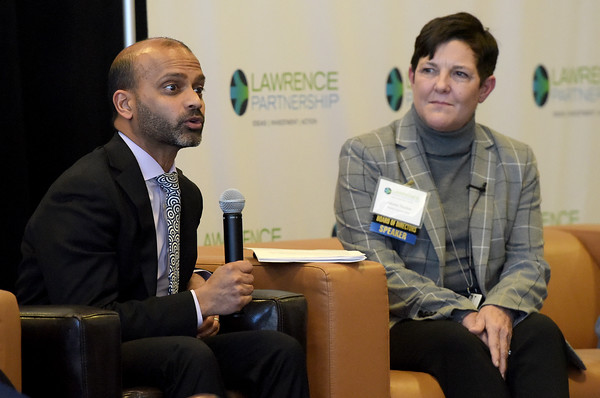 TIM JEAN/Staff photo <br /> <br /> Panelists Prabal Chakrabarti, left, Senior Vice-President Regional and Community Outreach Department, Federal Reserve Bank Boston leads a discussion as Julieann M. Thurlow, President and CEO, Reading Cooperative Bank listens during the Lawrence Partnership annual meeting held at IndusPad.     12/18/19