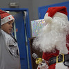 TIM JEAN/Staff photo <br /> <br /> Lewis Hernandez, 9, tells Santa what he would like for Christmas during Haverhill's Boys & Girls Club annual Christmas party.     12/13/19