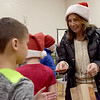 TIM JEAN/Staff photo <br /> <br /> Sammantha Faro, right, and her husband Joe Faro, owner of Tuscan Brands passed out gift cards to members of the Boys and Girls Club of Greater Salem.   12/18/19
