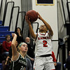 TIM JEAN/Staff photo <br /> <br /> Central's Nadeshka Bridgewater lays up the ball and scores over Pentuck's Angelica Yacubacci during the Commonwealth Motors Christmas Classic basketball tournament. Pentuck defeated Central 38-36.  12/31/19