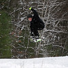 RYAN HUTTON/ Staff photo<br /> Benjamin Squires, 17, snowboards down the sledding hill at Alexander Carr Park in Derry on Monday.
