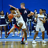 CARL RUSSO/Staff photo. Lawrence's Gabriel Zorrilla fights for the rebound with Central's Anthony Traficante. Lawrence high defeated Central Catholic 55-51 in the 7th. Annual Commonwealth Motors Christmas Classic basketball tournament. 12/27/2019