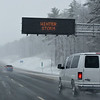 RYAN HUTTON/ Staff photo<br /> An electronic highway sign warns of winter storm conditions on I-93 N in Derry, Nh on Monday afternoon.