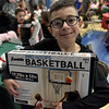 TIM JEAN/Staff photo <br /> <br /> Elijah Maya, 9, shows off the present he picked out during Haverhill's Boys & Girls Club annual Christmas party.     12/13/19