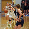 RYAN HUTTON/ Staff photo<br /> North Andover's Elle Dadiego drives the ball down court during the second period of Friday's home game against Andover.