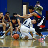 CARL RUSSO/Staff photo. Lawrence's Noah Tejada hits the floor fighting for the loose ball with Central's Jonathan Peguero, left and Xavier McKenzie. Lawrence high defeated Central Catholic 55-51 in the 7th. Annual Commonwealth Motors Christmas Classic basketball tournament. 12/27/2019