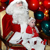 CARL RUSSO/Staff photo. Sophie Brown, four-months old has her first picture taken with Santa. Andover held their annual Holiday Happenings downtown and at the town park Friday night. 12/13/2019
