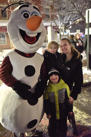 TIM JEAN/Staff photo <br /> <br /> Lisa Byrnes of Haverhill, and her children Cael 6, and her daughter Zoey 2, pose with Olaf the snowman from Disney's Frozen during the annual Christmas Stroll in downtown Haverhill. The event is sponsored by the Haverhill Chamber of Commerce.  12/6/19