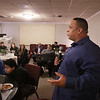 MIKE SPRINGER/Staff photo<br /> Jesus Ruiz, a former gang member who is now a chaplain with Leaving the Streets Ministry, speaks Thursday night during a meeting on how to combat gang activity and crime in Haverhill.<br /> 12/5/2019