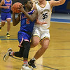 TIM JEAN/Staff photo <br /> <br /> Londonderry's Jackson Cox drives to the hoop against Andover's Michael Slayton during the Commonwealth Motors Christmas Classic basketball tournament.   12/27/19