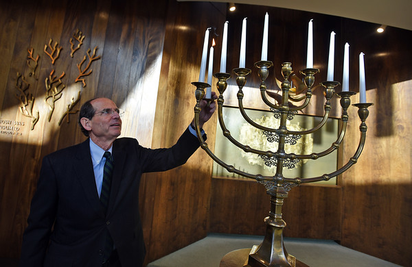 RYAN HUTTON/ Staff photo<br /> Rabbi Robert Goldstein will light his last menorah at Temple Emanuel during this Hanukkah as he plans to retire in June after more than 30 years in Andover.