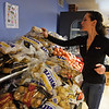 RYAN HUTTON/ Staff photo<br /> Amy Carter makes sure the fresh potatoes and onions are stocked on the shelves at the Liz Murphy Open Hand Food Pantry in Haverhill on Tuesday morning.