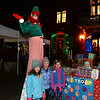 CARL RUSSO/Staff photo. From left, Annie Huffer, Lily Wiggins and Maisie Wenson, all 5 pose with a very tall elf in front of the Bancroft School Troop 70400 Daisy Girl Scouts cookie table. Wiggins and Wenson are members of the Daisy Scouts. Andover held their annual Holiday Happenings downtown and at the town park Friday night. 12/13/2019