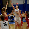 TIM JEAN/Staff photo <br /> <br /> North Andover's Caitlin Panos shoots over the Natick defense during the Commonwealth Motors Christmas Classic basketball tournament. Natick defeated North Andover 51-41.  12/28/19