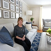 RYAN HUTTON/ Staff photo<br /> Homeowner Kate Duff sits  in her newly renovated and redesigned living room courtesy of  Gray Oak Studio.