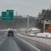 RYAN HUTTON/ Staff photo<br /> A sign warns drivers of plow trucks merging on to I-93 North near Derry, NH, during Monday's storm.