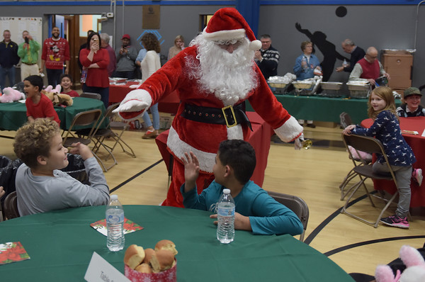 TIM JEAN/Staff photo <br /> <br /> Sant makes his way into the party for the Haverhill's Boys & Girls Club annual Christmas party.     12/13/19
