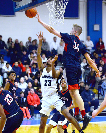 CARL RUSSO/Staff photo. Central's Anthony Traficante makes a clean block stopping Lawrence's Gabriel Zorrilla from making the basket. Lawrence high defeated Central Catholic 55-51 in the 7th. Annual Commonwealth Motors Christmas Classic basketball tournament. 12/27/2019