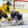 CARL RUSSO/Staff photo. UNH's goalie, Ava Boutilier makes the save as  Merrimack's Megan Fergusson looks for a shot on net. The Merrimack College Warriors were defeated by the University of New Hampshire Wildcats in women's hockey action Friday night.12/06/2019