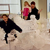 TIM JEAN/Staff photo <br /> <br /> Dan Allen, of Haverhill, poses behind an ice sculpture with his children Carter, 9, left, and Capri, 4, outside of Harbor Place during the annual Christmas Stroll in Haverhill.   12/6/19
