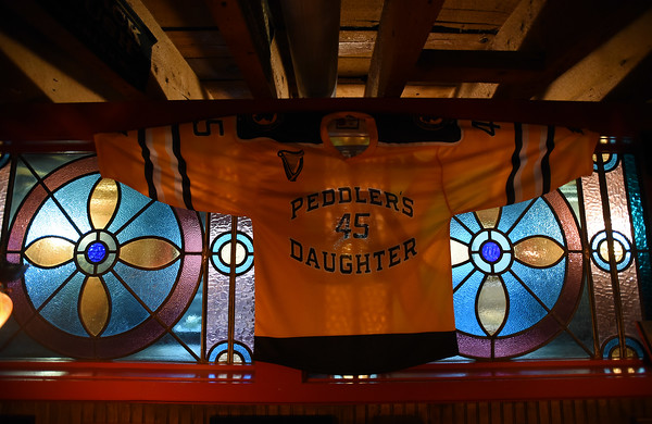 RYAN HUTTON/ Staff photo<br /> A decorative jersey hangs in the Peddler's Daughter.