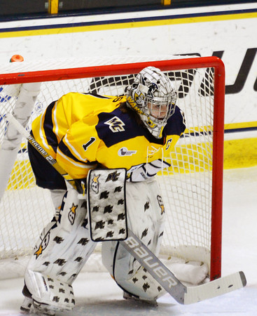 CARL RUSSO/Staff photo. Merrimack's goalie and captain, Lea-Kristine Demers ready for action.The Merrimack College Warriors were defeated by the University of New Hampshire Wildcats in women's hockey action Friday night.12/06/2019