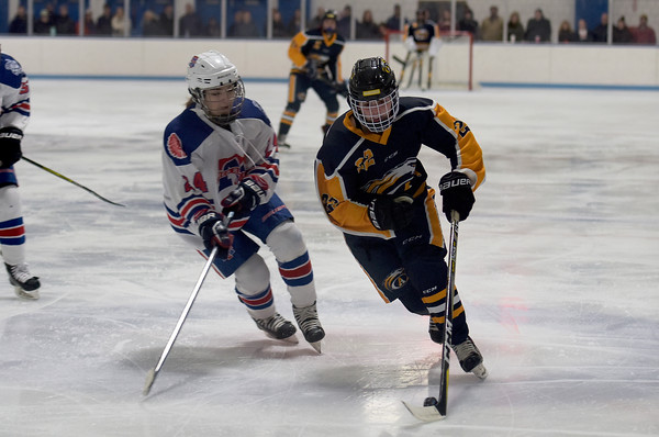TIM JEAN/Staff photo <br /> <br /> Andover's Lauren Adams, right, tries to get past Methuen/Tewksbury's Alexis Raymond during a girls hockey game. Andover won 4-3 in overtime.     12/21/19