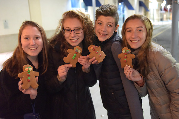 TIM JEAN/Staff photo <br /> <br /> Showing off the gingerbread cookies they decorated are from left, to right, Emma McLaughlin, 15, of Amesbury, Madison Dioni, 15, of Methuen, Drew Trembly, 14, and Kate Reagan, 15, both of Salem, NH., during the Methuen tree lighting festivities at The Loop shopping center.   12/7/19