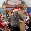 TIM JEAN/Staff photo <br /> <br /> Joe Faro, Tuscan Brands owner high fives children as he enters the gymnasium before he and his family pass out gift cards to members of the Boys and Girls Club of Greater Salem.   12/18/19