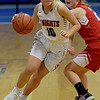 TIM JEAN/Staff photo <br /> <br /> North Andover's Hannah Whipple drives to the hoop past Natick's Lanney Ross during the Commonwealth Motors Christmas Classic basketball tournament.   12/28/19