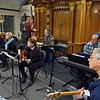 """RYAN HUTTON/ Staff photo<br /> Rabbi Howard Mandell, standing rear, speaks to the members of """"Bashert"""" - meaning destiny or destined -  the Congregation Beth Israel house band before the Shabbat celebration on the first night of Hanukkah on Friday."""