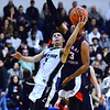CARL RUSSO/Staff photo. Lawrence's Abraham Estrada drives to the hoop against Central's Marcus Rivera. Lawrence high defeated Central Catholic 55-51 in the 7th. Annual Commonwealth Motors Christmas Classic basketball tournament. 12/27/2019