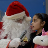 TIM JEAN/Staff photo <br /> <br /> Kyanalis Gonzales tells Santa what she would like for Christmas during Haverhill's Boys & Girls Club annual Christmas party.     12/13/19