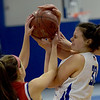TIM JEAN/Staff photo <br /> <br /> Methuen's Marren Donovan, right, battles for the loose ball against Tewksbury's Alexis Polimeno during a girls basketball game. Methuen lost 49-26.     12/19/19