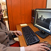 RYAN HUTTON/ Staff photo<br /> Gwen Junghanss, department head of reference at the Haverhill Public Library, pulls up an archival picture of Winnekenni Castle in the special collections room of the library using the newly updated Senter Digital Archive.