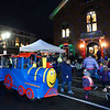 CARL RUSSO/Staff photo. The crowd gathers outside the Old Town Hall. Andover held their annual Holiday Happenings downtown and at the town park Friday night. 12/13/2019