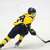 CARL RUSSO/Staff photo. Merrimack's Megan Fergusson looks for the pass.The Merrimack College Warriors were defeated by the University of New Hampshire Wildcats in women's hockey action Friday night.12/06/2019