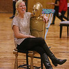 MIKE SPRINGER/Staff photo<br /> Heather Langlois, District Art Facilitator for Lawrence Public Schools, sits on a chair designed to look like the Star Wars character C-3PO during a student art show Thursday evening at Everett Mills in Lawrence.<br /> 12/5/2019