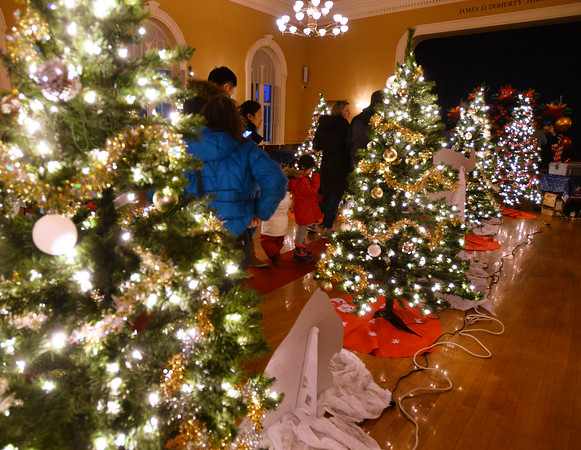 CARL RUSSO/Staff photo.  Christmas trees decorate the Old Town Hall. Andover held their annual Holiday Happenings downtown and at the town park Friday night. 12/13/2019