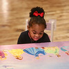 MIKE SPRINGER/Staff photo<br /> Three-year-old Nova Napoleon of Methuen looks at a table painted with Disney princesses during a student art show Thursday evening at Everett Mills in Lawrence.<br /> 12/5/2019