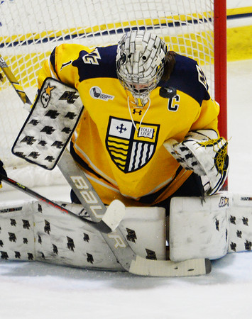CARL RUSSO/Staff photo. Merrimack's goalie and captain, Lea-Kristine Demers keeps her eye on the puck after making the save. The Merrimack College Warriors were defeated by the University of New Hampshire Wildcats in women's hockey action Friday night.12/06/2019