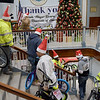 TIM JEAN/Staff photo <br /> <br /> Construction workers from Brady Sullivan Properties, who are building apartments in the Pacific Mills Lofts carry bicycles up the stairs of Lawrence City Hall that are being donated.     12/13/19