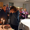 RYAN HUTTON/ Staff photo<br /> Members of Congregation Beth Israel in Andover gather for a blessing at the start of the Shabbat celebration on the first night of Hanukkah on Friday.