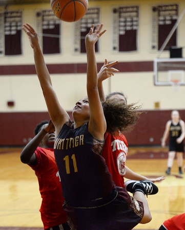 CARL RUSSO/Staff photo. Whittier's Aliyah Talley fights her way to the hoop for the basket. Whittier Tech scrimmaged against Lynn Tech in girls basketball action Monday afternoon. 12/09/2019