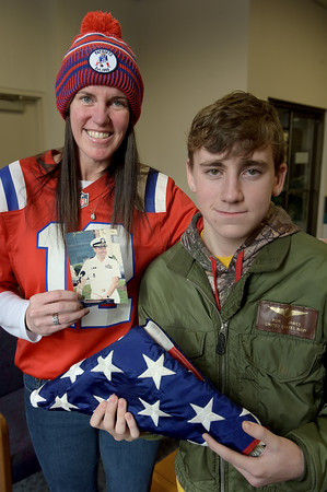 TIM JEAN/Staff photo <br /> <br /> Brandan Guenard, right, 14, of Andover, received a sentimental bomber jacket from Kelly James, of Nashua, who gifted it on behalf of her father Ron James, who was Navy Commander.  12/21/19